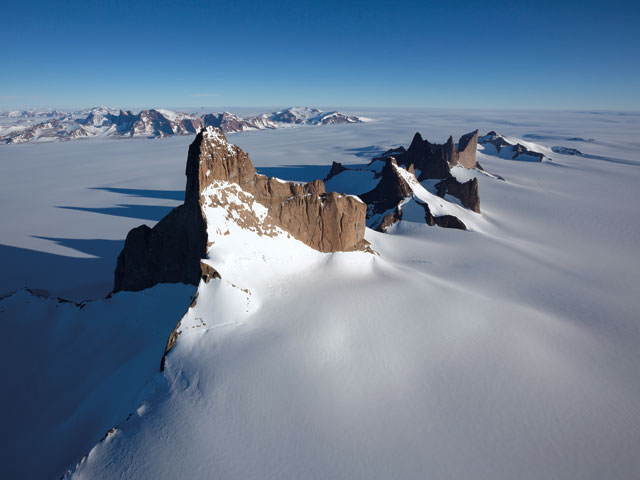 Aerial view of the west face of Ulvetana, scene of the first ascent in 1994. The NE ridge is the profile on the left.