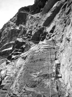 The Land of Rock Climbing Legends. Heinz Kahl leading the last pitch on the first ascent of Red Shirt in 1962.